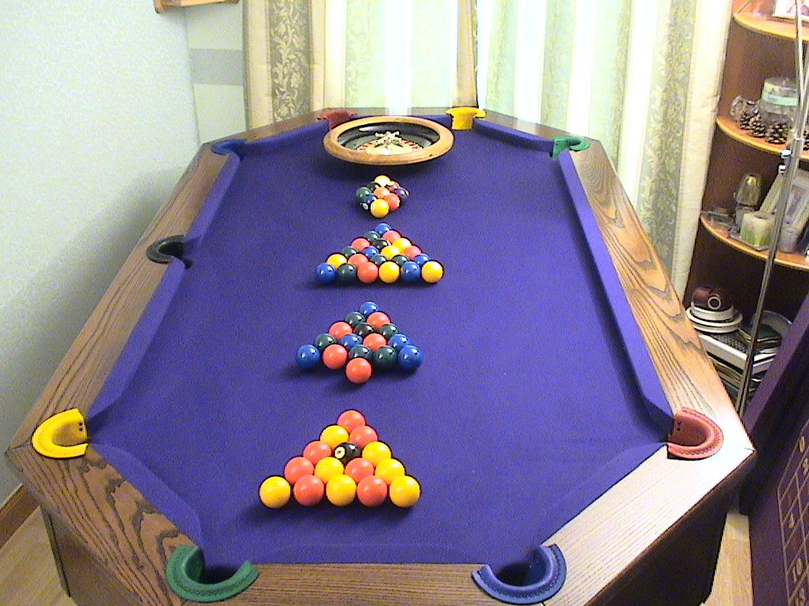 Octapool Table with 4 sets of Balls and roulette wheel